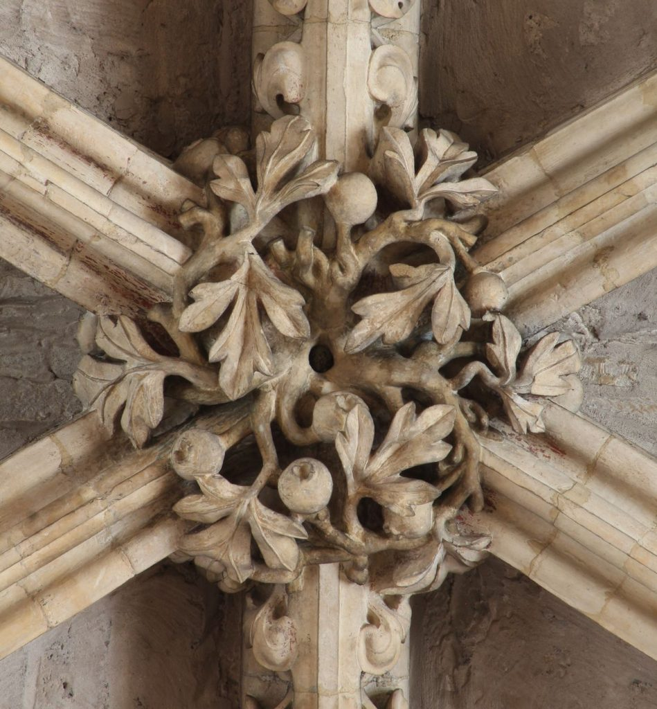 Image of a boss in the Angel Choir at Lincoln Cathedral, showing hawthorn with berries