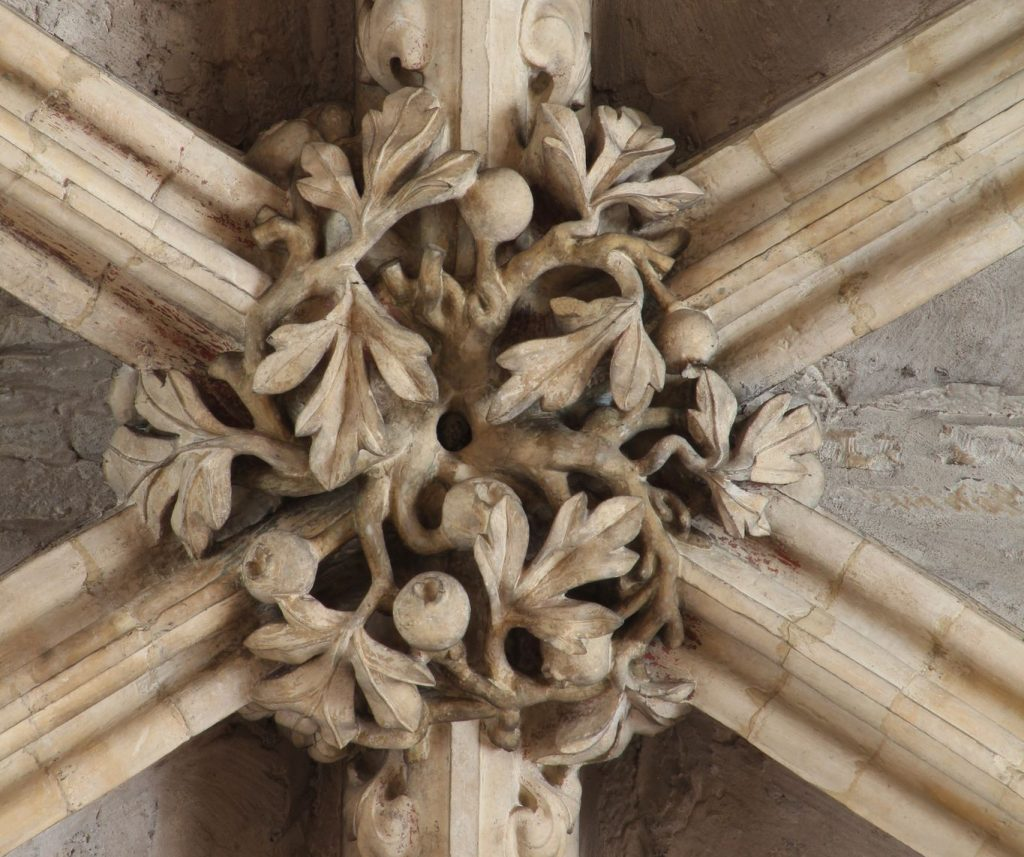 Image of boss from the Angel Choir at Lincoln Cathedral, showing hawthorn with berries