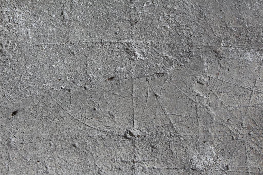 Detail of the tracing floor at Wells Cathedral, showing incised markings related to the corner of the design for the vault in the east walk of the cloister at Wells