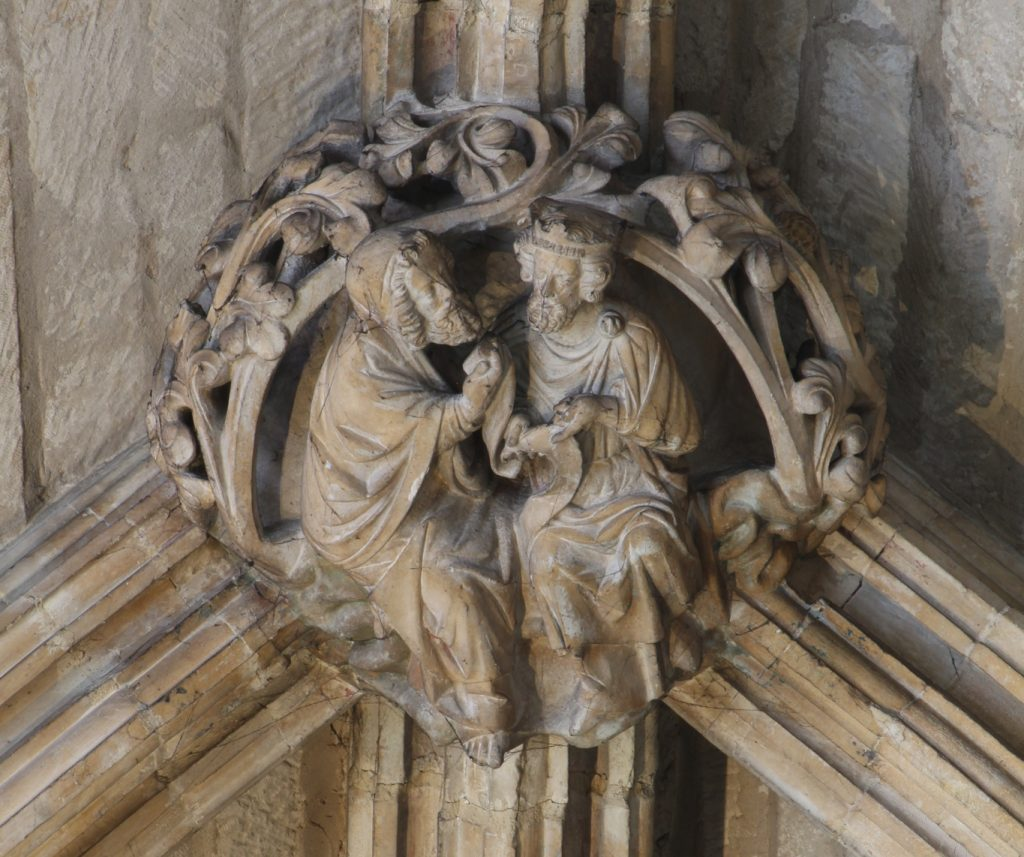Image of boss in the Angel Choir aisle at Lincoln Cathedral, showing a discussion between a king and an elder, probably a scene from the Old Testament