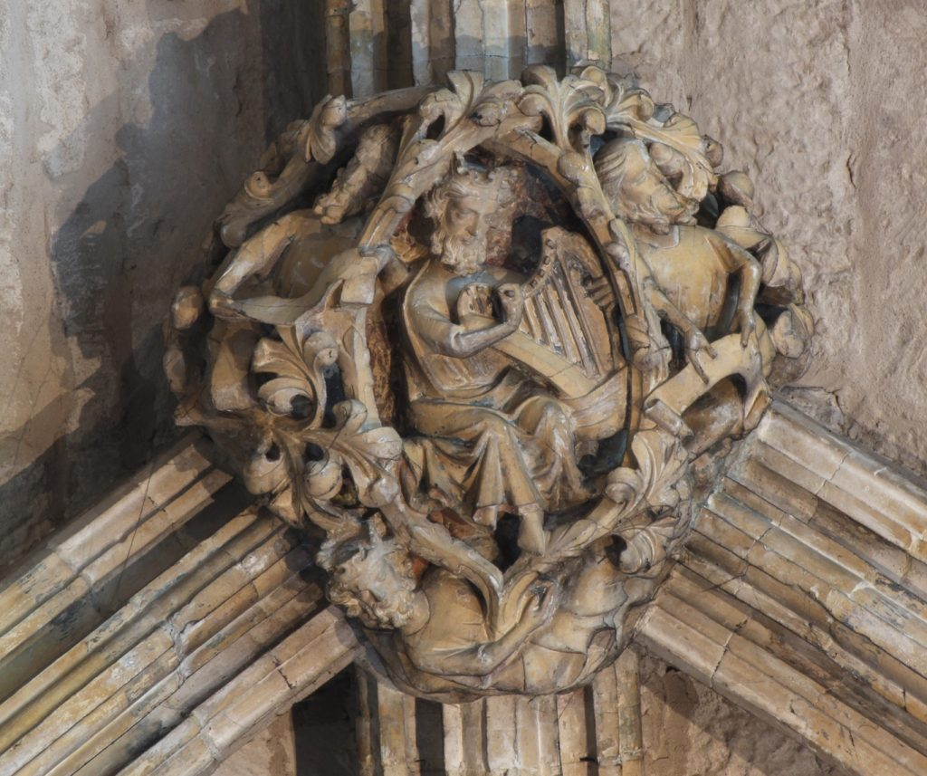 Image of boss in the Angel Choir aisle at Lincoln Cathedral, showing King David playing a harp