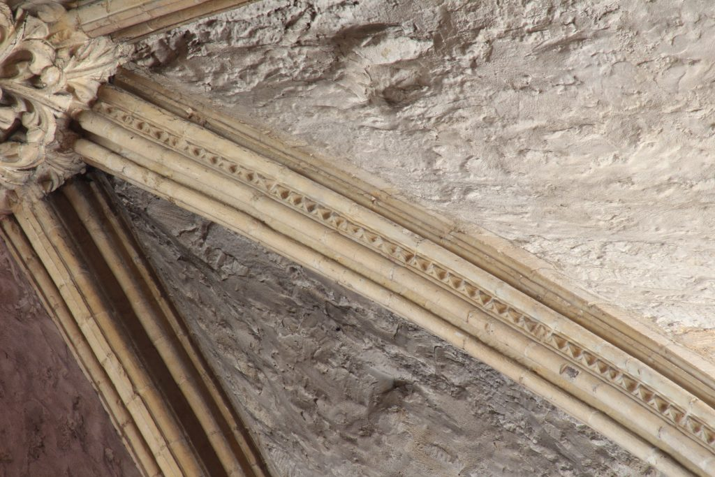 Image of dogtooth pattern rib moulding in the south arm of the east transept at Lincoln Cathedral