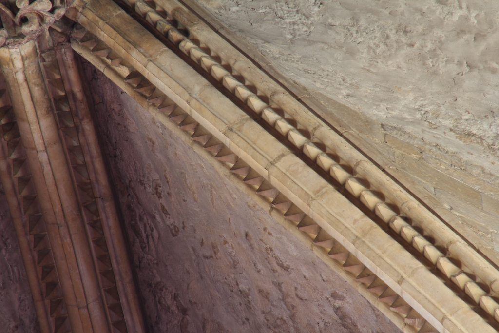 Image of dogtooth pattern rib moulding in the southernmost bay of the east transept at Lincoln Cathedral