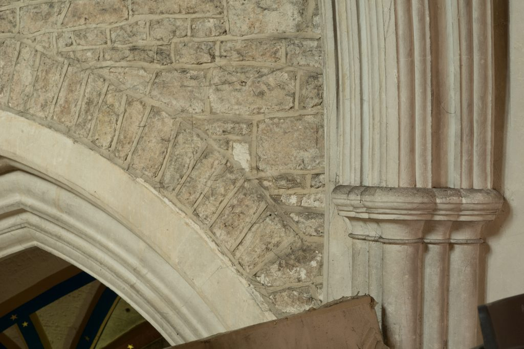 Image of rubble masonry in a spandrel on the north side of the easternmost bay of the nave at Ottery St Mary