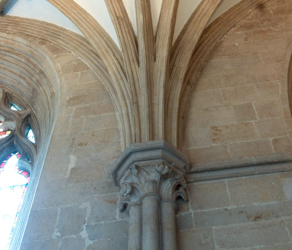 Image of tas-de-charge stones in the south wall of the south choir aisle at Wells Cathedral