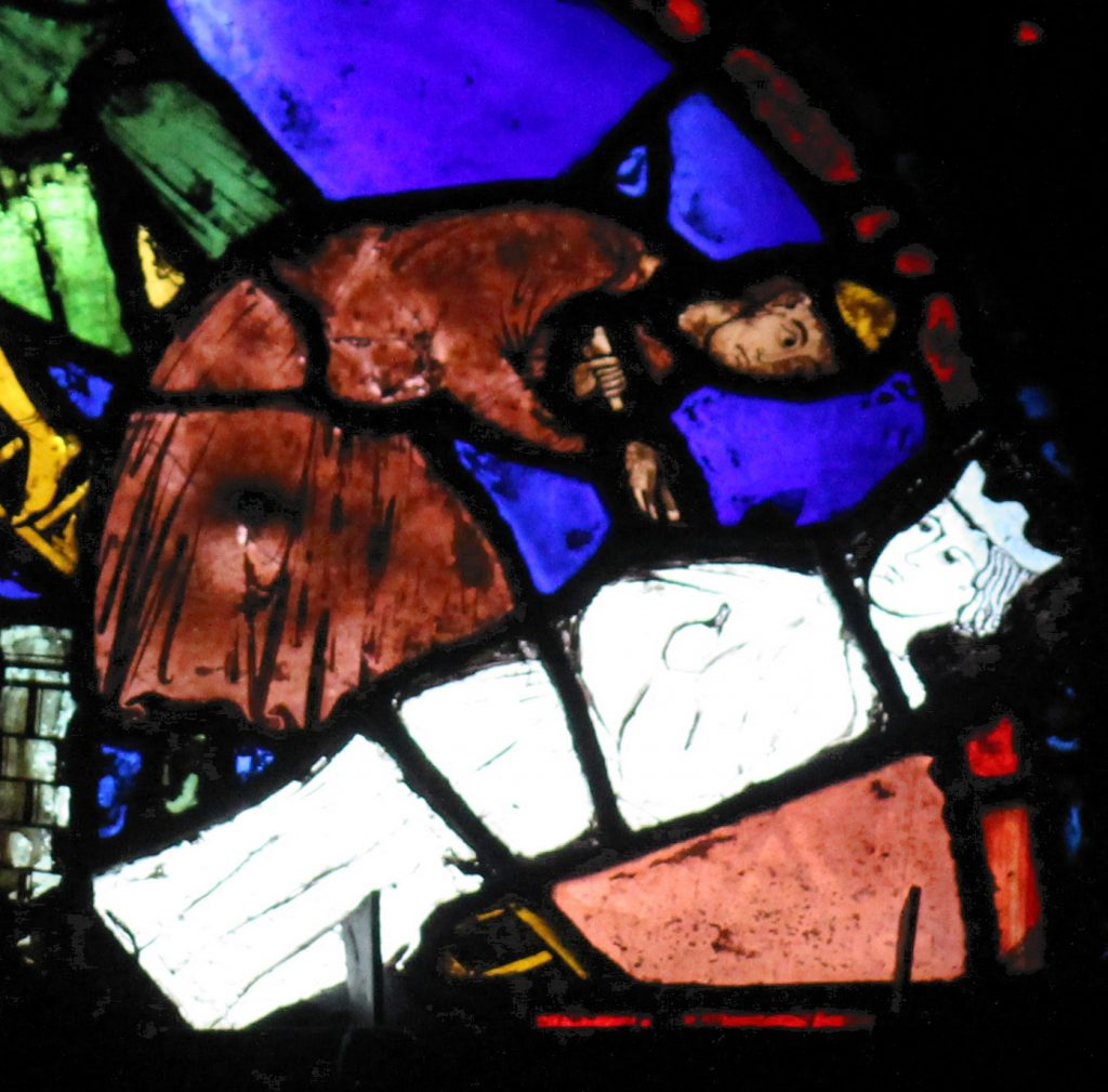 Image of a mason at work from the base panels of the St Cheron window at Chartres Cathedral